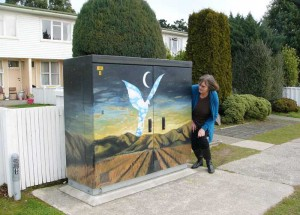 Mary Napper with a Chorus cabinet in Yarrow Street, Glengarry, that has received a welcome facelift.