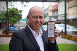 Deputy Mayor Darren Ludlow logging into the new Council Wi-Fi in the city centre.